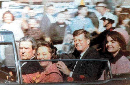 Amateur snapshot, made with Kodak Brownie, of the Kennedys and Connallys in the motorcade about two minutes before the shooting in Dealey Plaza.