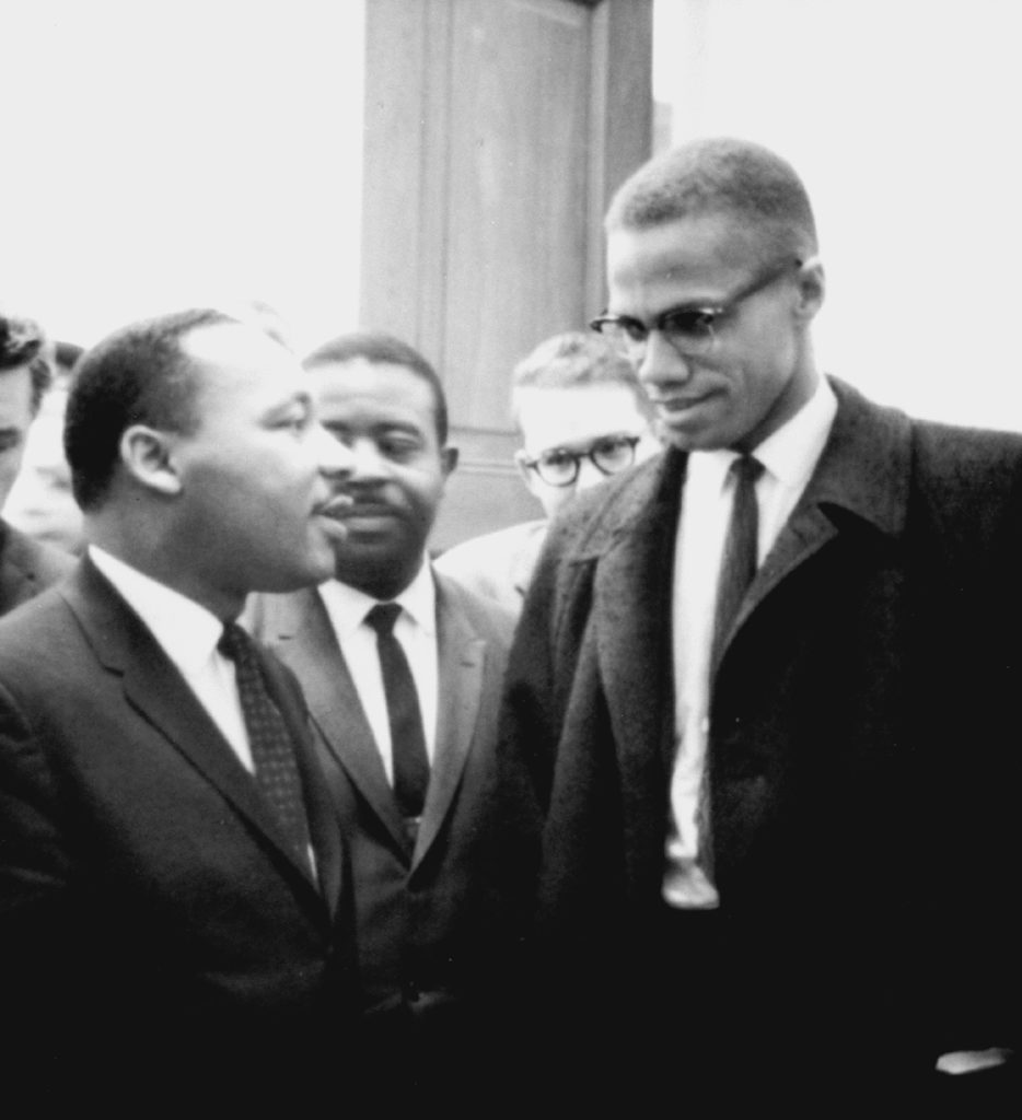 Martin Luther King, Jr. and Malcolm X meet on March 26, 1964. Both men had come to hear the senate debate on the Civil Rights Act of 1964.