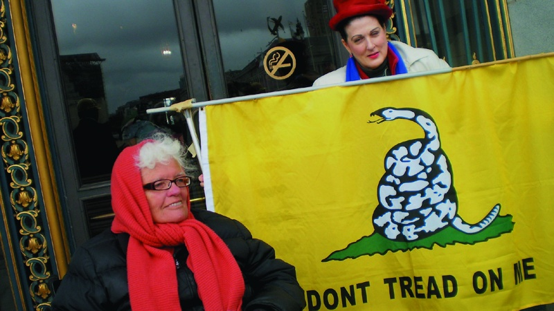 """Don't Tread On Me."" A timely message from homeless people. Carol Harvey photo"