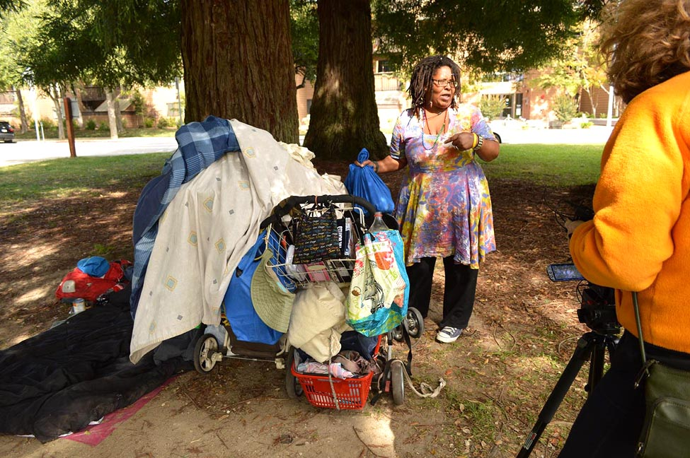 "A woman named Butterfly packs her belongings in San Lorenzo Park in Santa Cruz. This photo was taken by Natalia Banaszczyk as part of a Santa Cruz project called ""Not the Other: Oral Histories of People Experiencing Homelessness."""