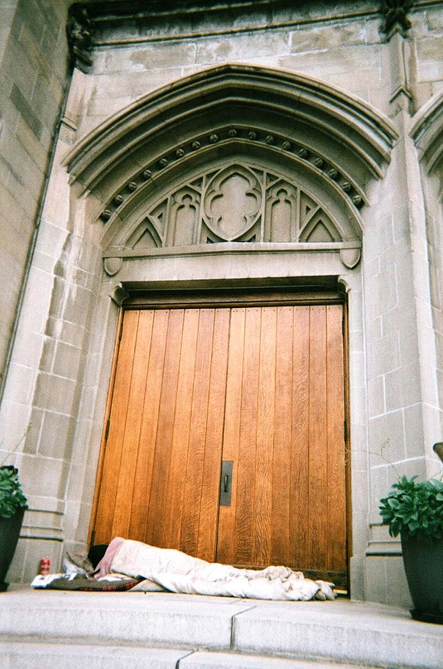 "Church.jpg ""Heavenly Threshold.""  A homeless man finds refuge in a church doorway in Oakland. Pedro Del Norte photo"
