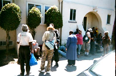 """Coming Together to Eat."" People line up to eat at a church in Berkeley. ""Churches have been helping poor people for a long time. They provide nutritional food which enables people to live and have hope.""  Vernon Andrews photo"