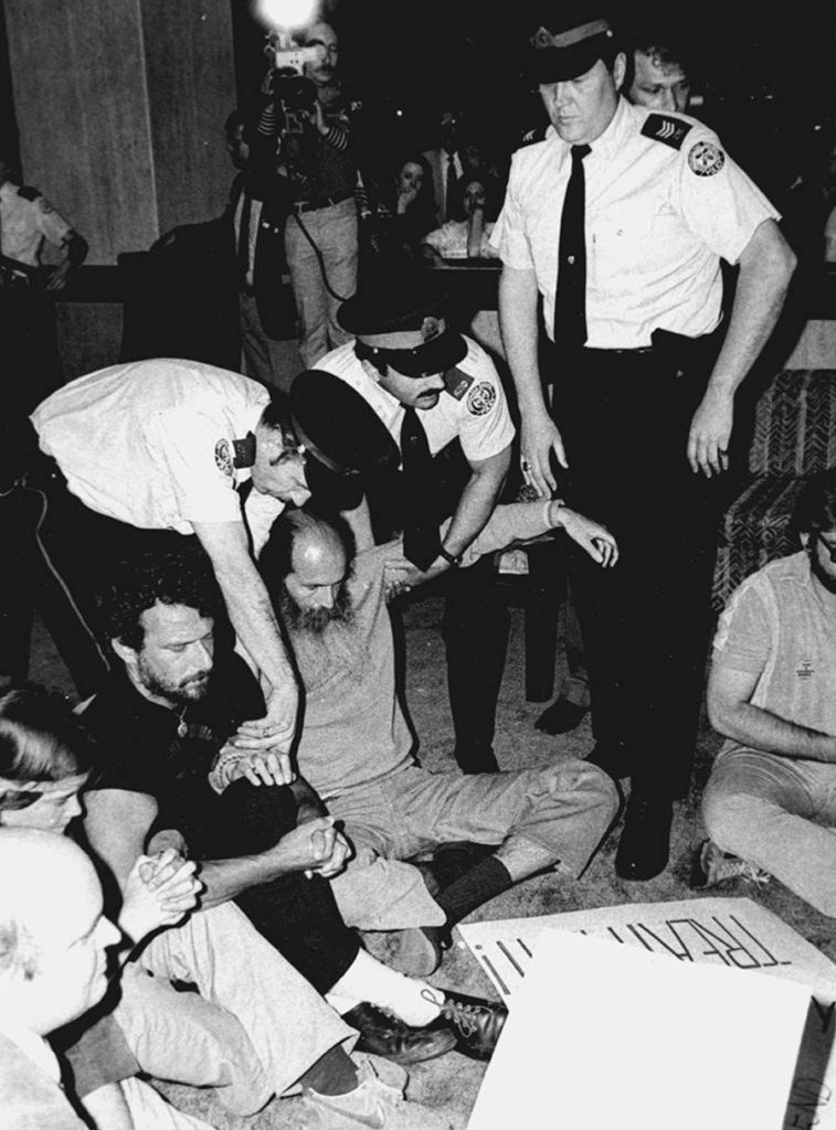 Leonard Roy Frank is arrested in Toronto during a sit-in at the American Psychiatric Association convention on May 17, 1982. Photo by Wood, The Globe and Mail
