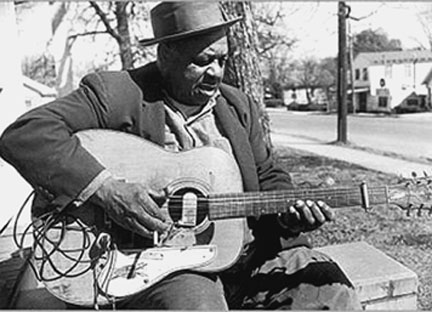 Big Joe Williams plays the unique nine-string guitar that he invented to give his blues a distinctive sound. Big Joe wrote a profoundly moving tribute to Martin Luther King.