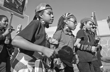 Children in a march celebrating the birthday of Rev. Martin Luther King Jr.