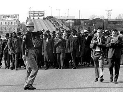 Selmapolice.jpg Police in Selma, Alabama, wait for civil rights marchers as they cross the Edmund Pettus Bridge.