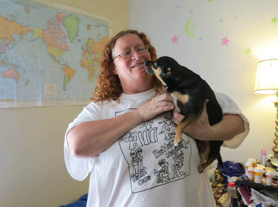 Cynthia and her dog Maggie share an SRO room at the Mission Hotel. Amy Ma photo