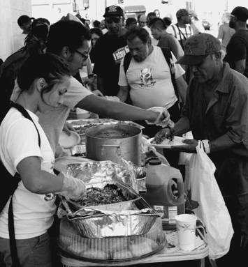 Food Not Bombs in Los Angeles provides a free meal, as part of a picnic on Skid Row to defend the right to share food. Photo by Dan Bluemel LA Activist