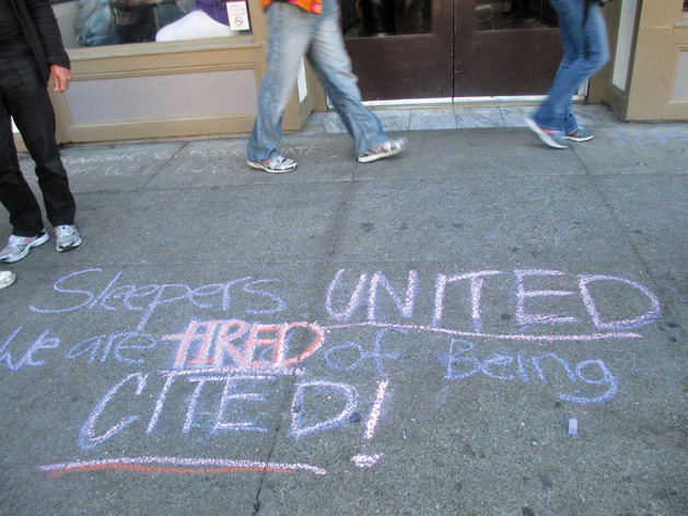 "The finished message: ""Sleepers United. We are tired of being cited!"" Dozens of chalked messages have been written on Berkeley sidewalks. Sarah Menefee photo"