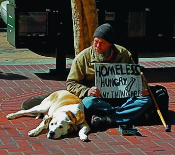 A homeless man and his dog ask for food in San Francisco. Robert L. Terrell photo