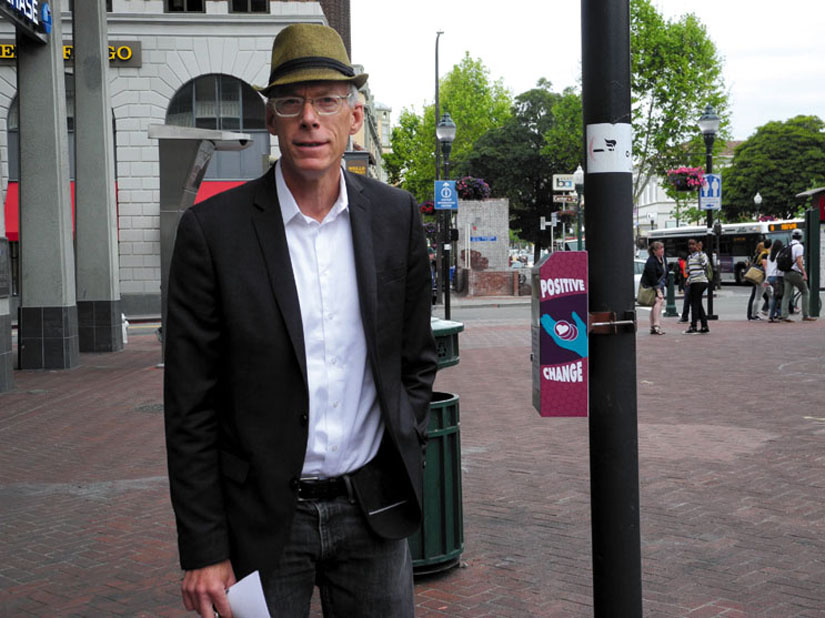 John Caner stands next to his Positive Change box on the pole. Caner has been instrumental in developing anti-homeless laws in Berkeley.  Carol Denney photo