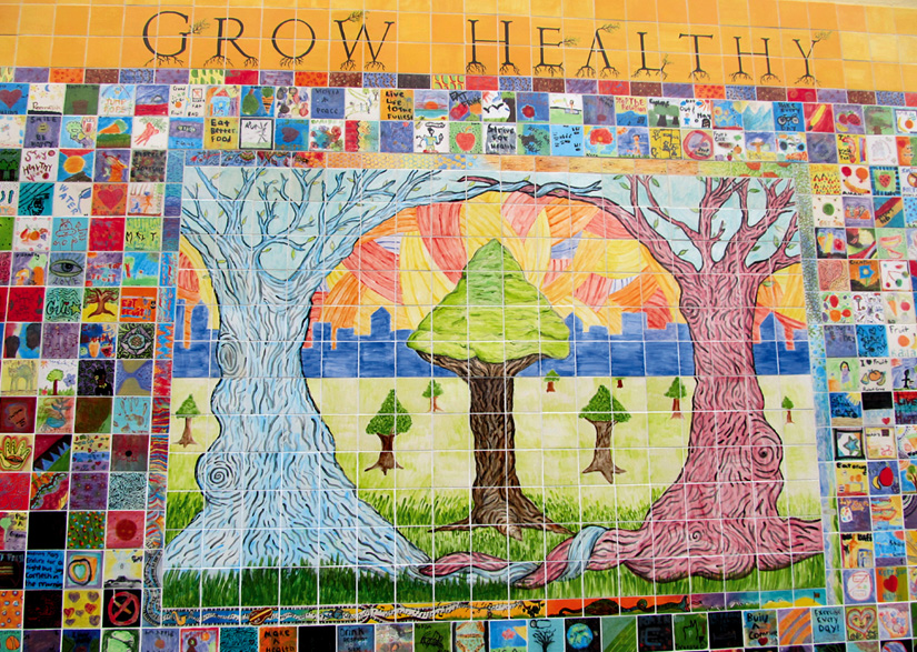 """GROW HEALTHY."" Young artists working with Youth Spirit Artworks created this tile mural to educate the public about the severe health disparity between low-income and wealthy residents in Berkeley."