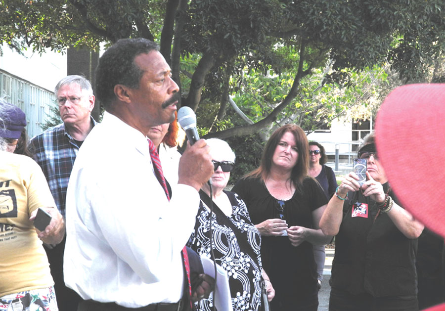 Mansour Id-Deen of the Berkeley NAACP speaks at the rally before the City Council hearing on the proposed anti-homeless laws. Carol Denney photo
