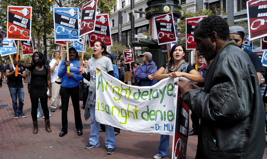 "Protesters condemn the harassment of poor people by security forces of the Union Square Business Improvement District in San Francisco. The sign says: ""A right delayed is a right denied.""   Janny Castillo photo"