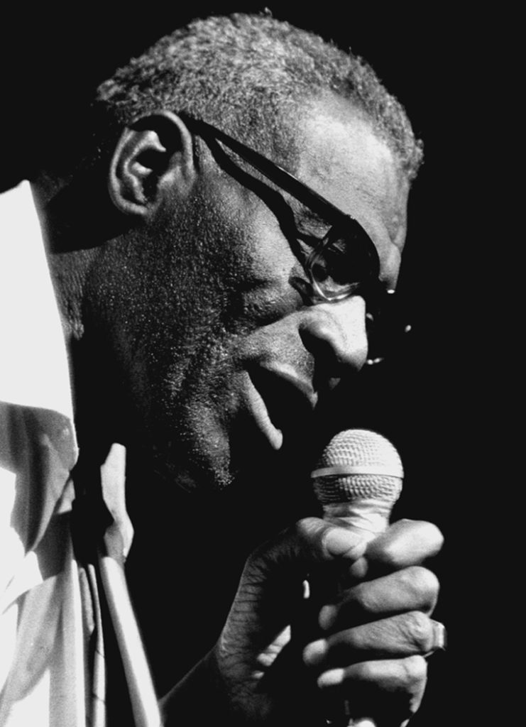 Howlin' Wolf singing in 1972. Wolf's hard-charging blues band first recorded in Memphis, then took the spirit of the Mississippi Delta blues to Chicago.