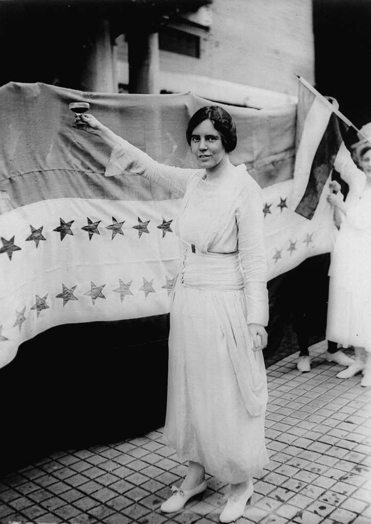 Suffragist leader Alice Paul raises a glass to the voting rights amendment for women.