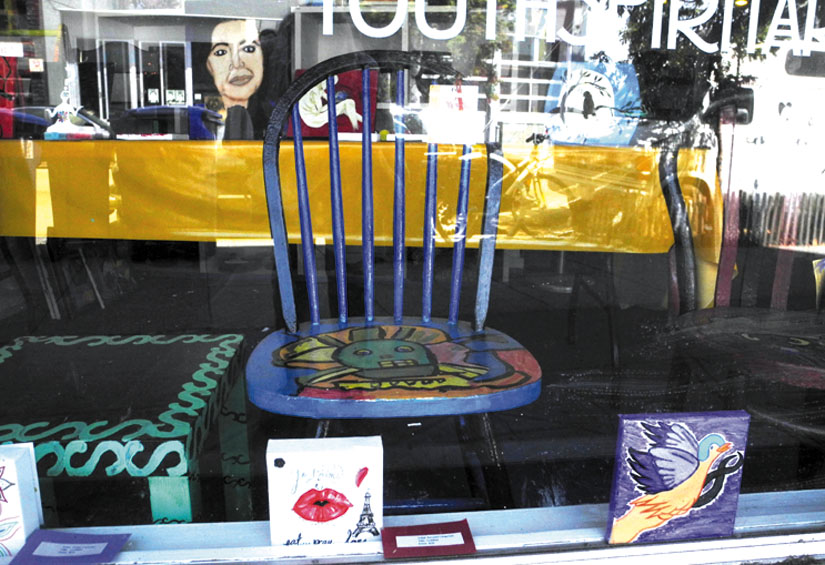 A painted chair in the front window of Youth Spirit Artworks. Carol Denney photo