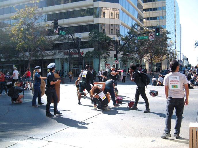 Theater groups occupied street intersections in downtown Oakland in protest of Urban Shield exercises and police repression.