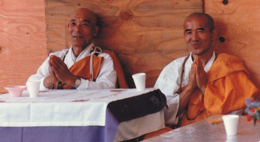 Two Buddhist  monks of the Nipponzan Myohoji order pray for peace inside the geodesic done at Ground zero.