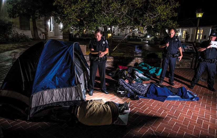 Santa Cruz police roust Freedom Sleepers during the sleep-out protests at Santa Cruz City Hall. Alex Darocy photo