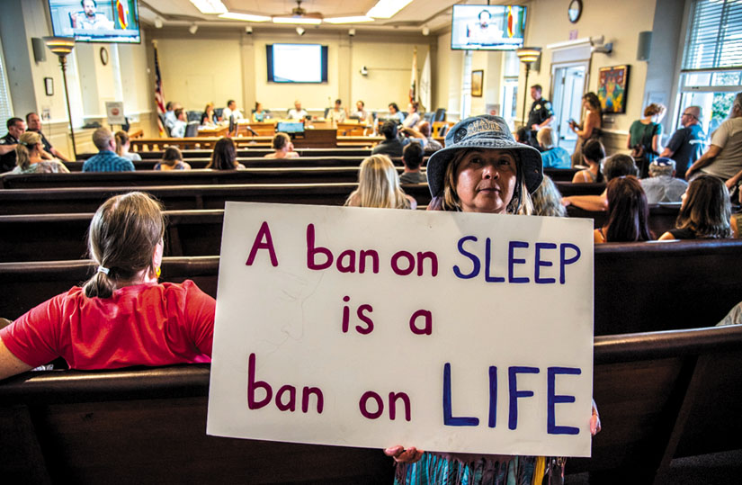 Life.jpg Freedom Sleepers take their message of protest inside the chambers of the Santa Cruz City Council.  Photo by Alex Darocy