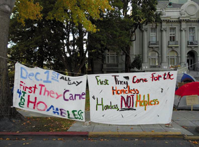 """First They Came for the Homeless."" An eye-catching banner hangs in front of the occupation on Martin Luther King Street in front of Berkeley City Hall. Lydia Gans photo"
