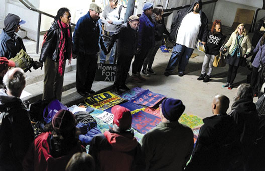 Homeless advocates begin an all-night vigil in front of old City Hall in protest of the Berkeley City Council's anti-homeless laws. Photo credit: Kevin Cheung, Daily Cal