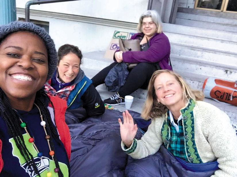 Four women who played inspiring roles in organizing a vigil and sleep-out at City Hall. From left to right, Moni Law, Genevieve Wilson, Elisa Cooper and Sally Hindman.