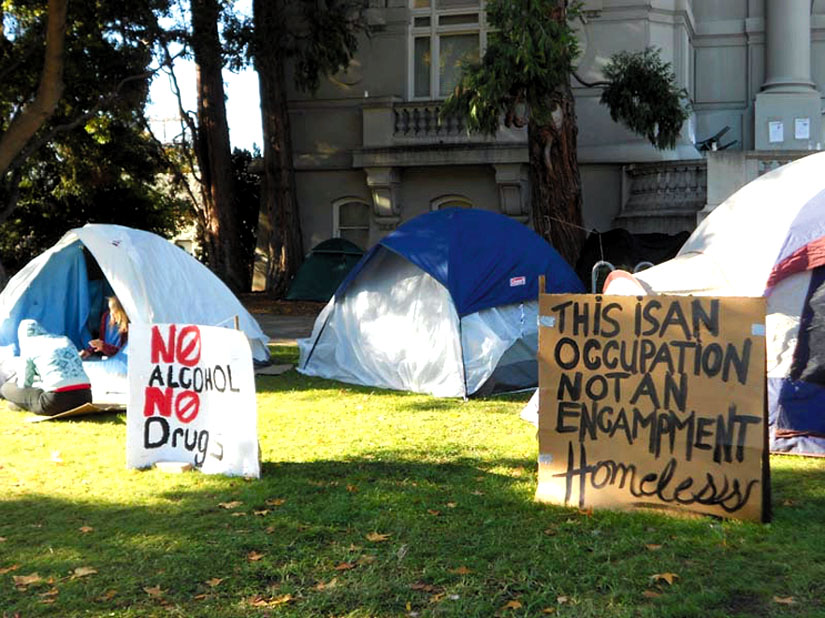 "A sign in front of a tent at Berkeley's old City Hall bears this message: ""This is an occupation, not an encampment."" Lydia Gans photo"