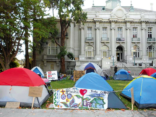 Homeless people have set up tents at City Hall and have created an occupation to make visible the injustices and hardships faced by homeless people. Lydia Gans photo