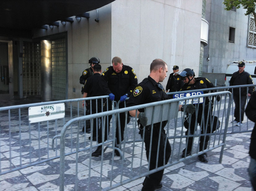 Sherrifs put up barricades at San Francisco's Hall of Justice. Stever Rhodes photo