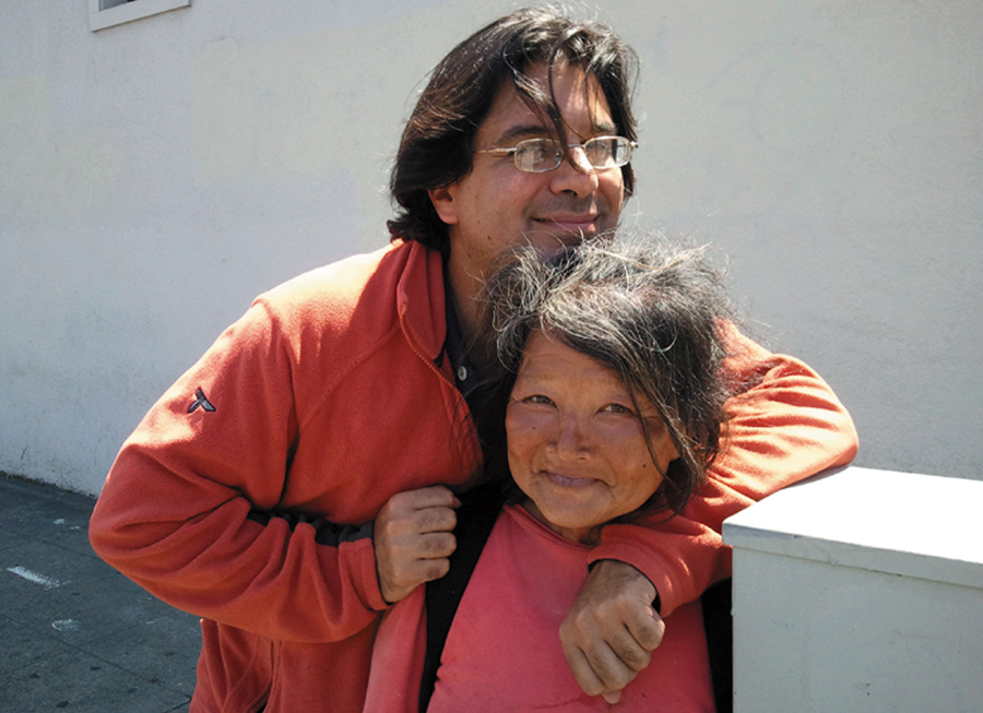 Amir Soltani, producer and co-director of Dogtown Redemption, hugs Miss Hayok Kay, a woman recycler who was featured in the film. Kay was well-loved by many friends, but ended up in the East Bay. She was killed in a brutal assault while living on the street.
