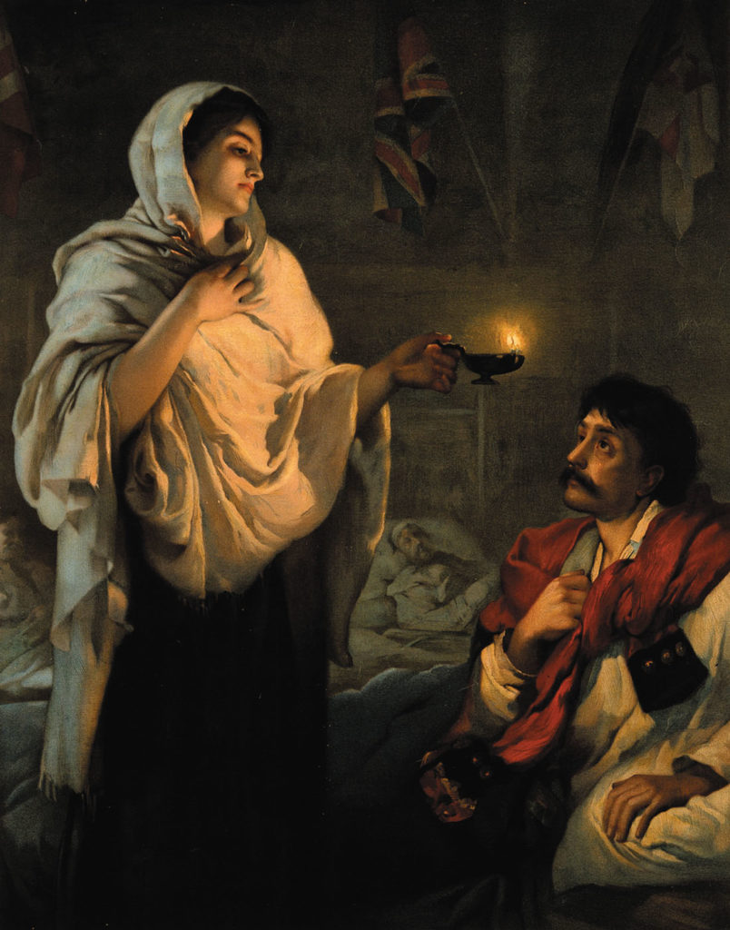 """The lady with the lamp."" Florence Nightingale at Scutari with her lamp at a patient's bedside in the Crimean War. Lithograph of a painting of Nightingale by Henrietta Rae."