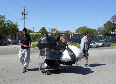 Recyclers push heavy, overburdened carts down Oakland streets. Lydia Gans photos