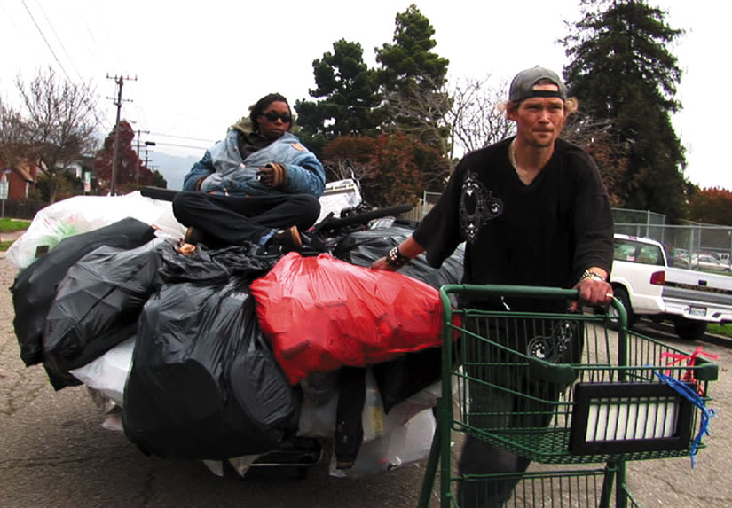 Jason Witt and Heather Holloway carry massive amounts of recycled materials to Oakland centers every day.