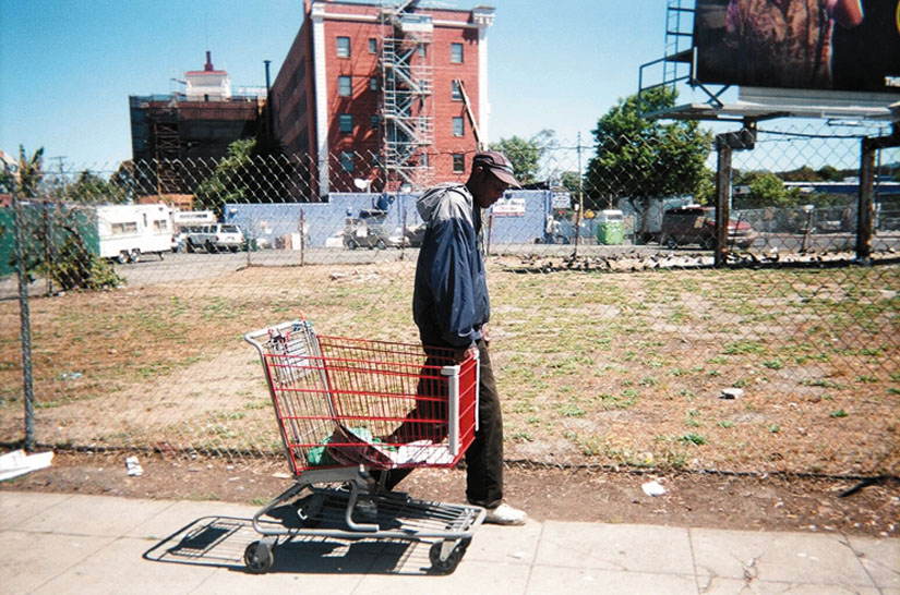 """A Way to Survive."" Keith Arivnwine took this photo as part of ""On Our Way Home,"" a photography exhibit created by St. Mary's Center. ""When I was homeless, I used a shopping cart to carry my belongings and to recycle,"" said Arivnwine."