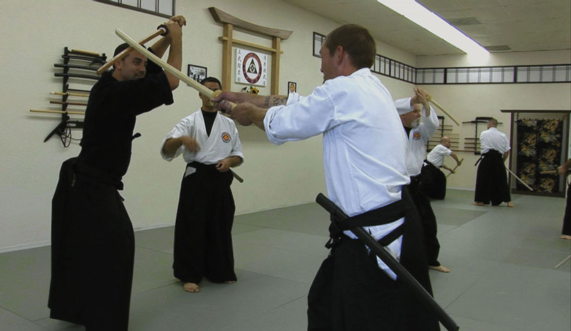 Jason Witt (at right, in white) undergoes martial arts training at the Contra Costa Budokan Martial Arts Academy.