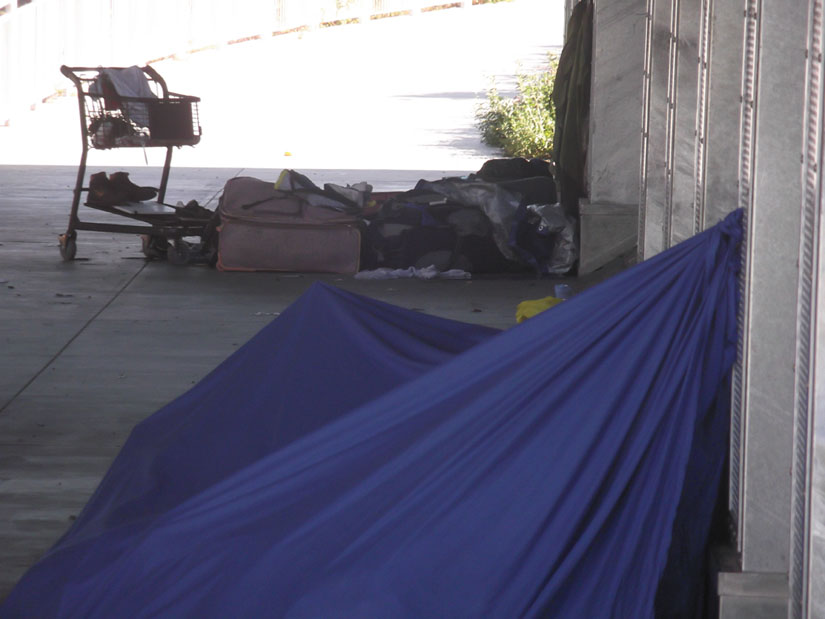 All that remains of a homeless encampment after Oakland officials dismantled it and the homeless occupants were driven away. Photo by Kheven LaGrone