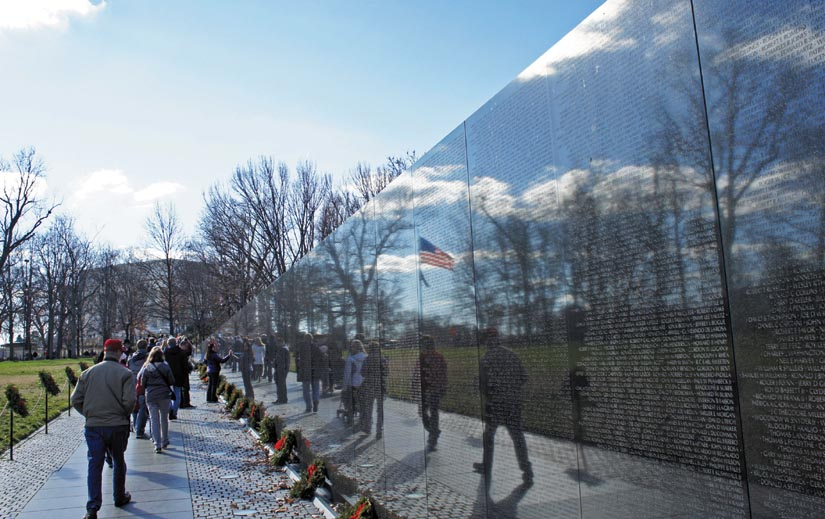 Images of visitors are reflected in the Vietnam Veterans Memorial Wall at the National Mall in Washington, D.C. Photo by Mario Roverto Duran Ortiz