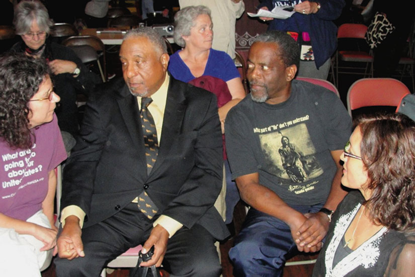 Dr. Bernard Lafayette (center, in suit) discusses nonviolence with activists in Oakland. Lafayette was chosen by Martin Luther King to direct the Poor People's Campaign in 1968, and now teaches Kingian Nonviolence. Photo by Howard Dyckoff