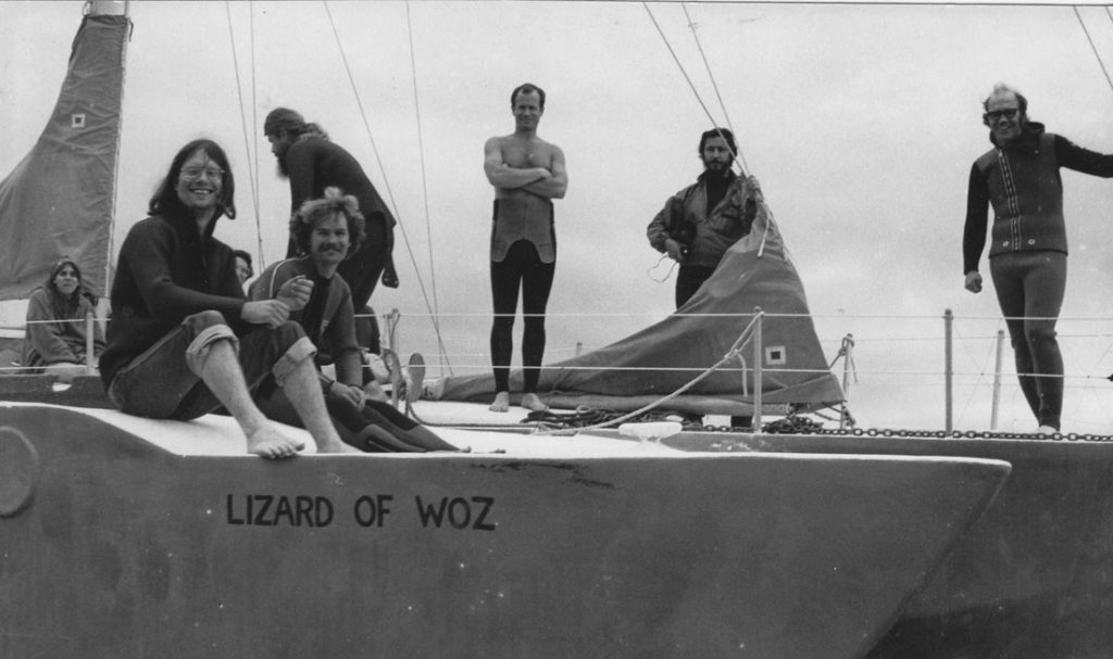 The Lizard of Woz sailboat prepares to sail in the peace blockade of the USS Ohio, the first Trident nuclear submarine, as it entered Puget Sound. Jim Douglass stands at far right, Terry Messman sits at left foreground, Darla Rucker sits at far left.