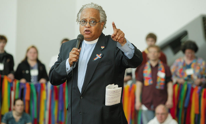 The Rev. Phil Lawson rallies supporters of full rights for gays and lesbians in the United Methodist Church. Rev. Lawson, the retired pastor of Easter Hill United Methodist Church, dedicated his entire life to working for justice. Photo by Mike DuBose.
