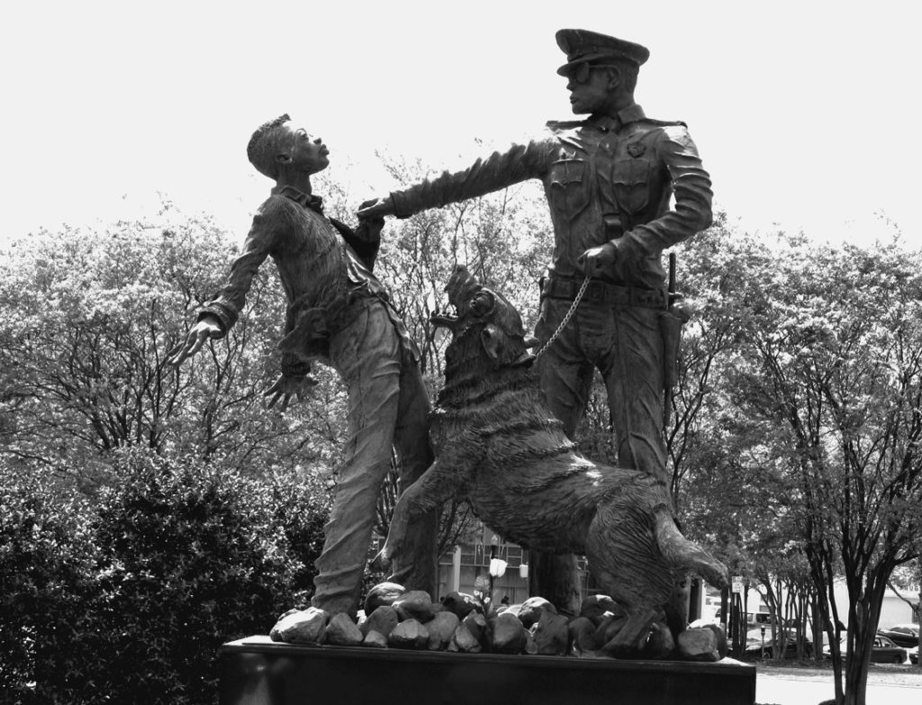 This sculpture depicts the brutal police attacks on young civil rights marchers in Birmingham, Alabama. Several sculptures by James Drake are located in Kelly Ingram Park, a key staging area for the civil rights movement. Terry Messman photo