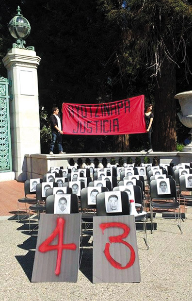 Students organized this demonstraton at the University of California at Berkeley where they placed the photos of the 43 disappeared student teachers of Ayotzinapa in empty school chairs.