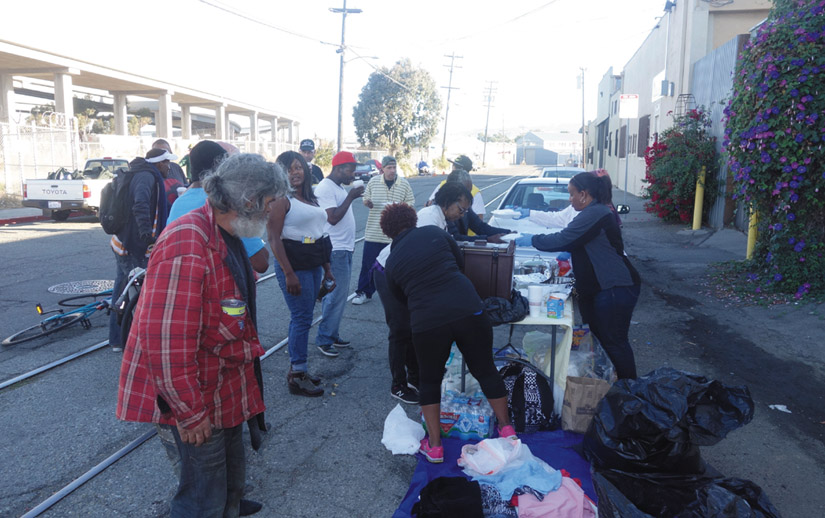 While some Oakland residents are bringing meals and needed supplies to their homeless neighbors, other affluent residents are asking city officials and the police to dismantle and evict homeless encampments. Kwalin Kimaathi photo