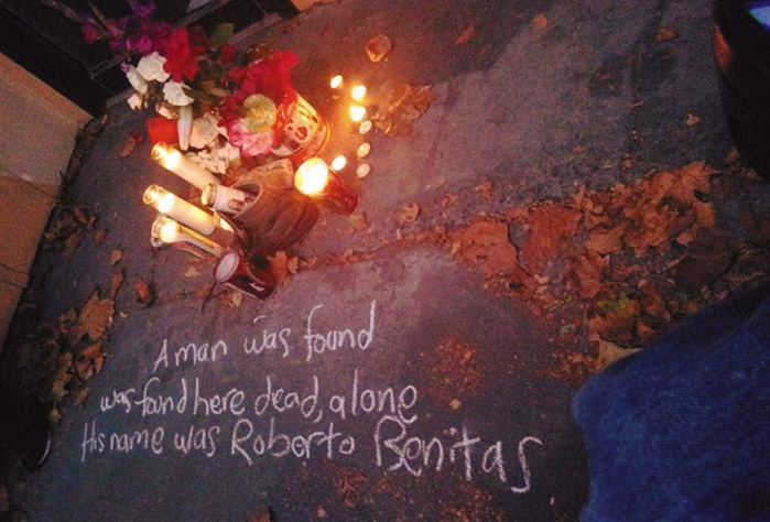 "Flowers and candles were placed as a memorial on the sidewalk where a day laborer died in Berkeley. Written in chalk are the words: ""A man was found here dead, alone. His name was Roberto Benitez."" Daniel McMullan photo"